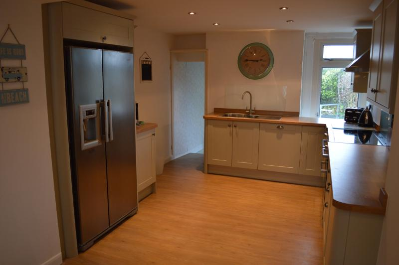 Kitchen - American style fridge freezer providing chilled water and ice