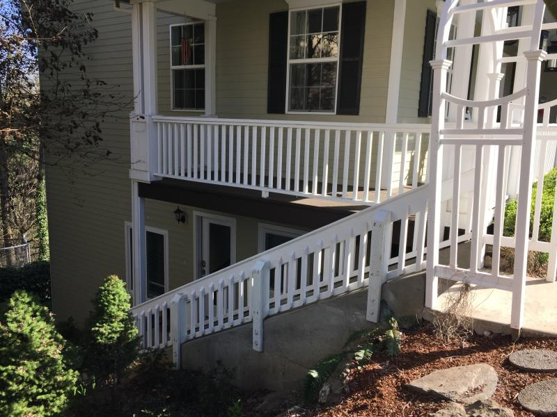 Stairs lead down to the front door.