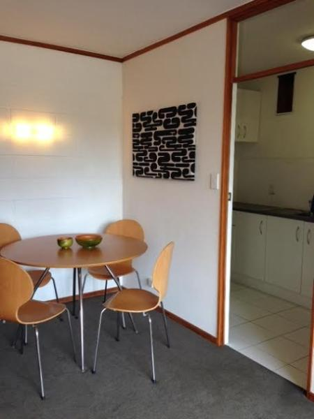 Cosy corner dining table with separate kitchen.