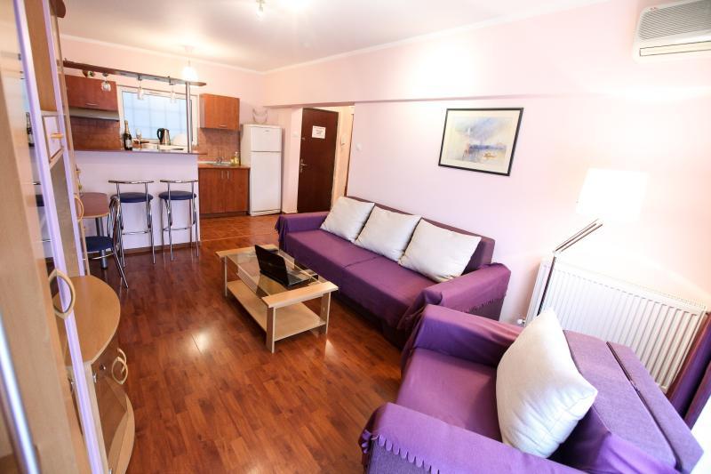 Salle de séjour appartement - Romana Square - Eva