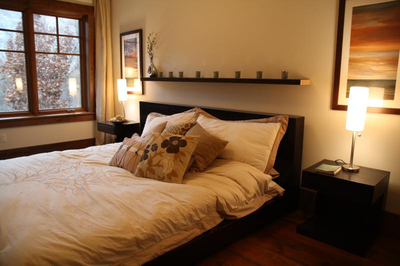 Master bedroom overlooking the forest.  King-sized bed.