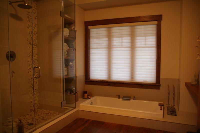 Bathroom with oversized sunken tub.