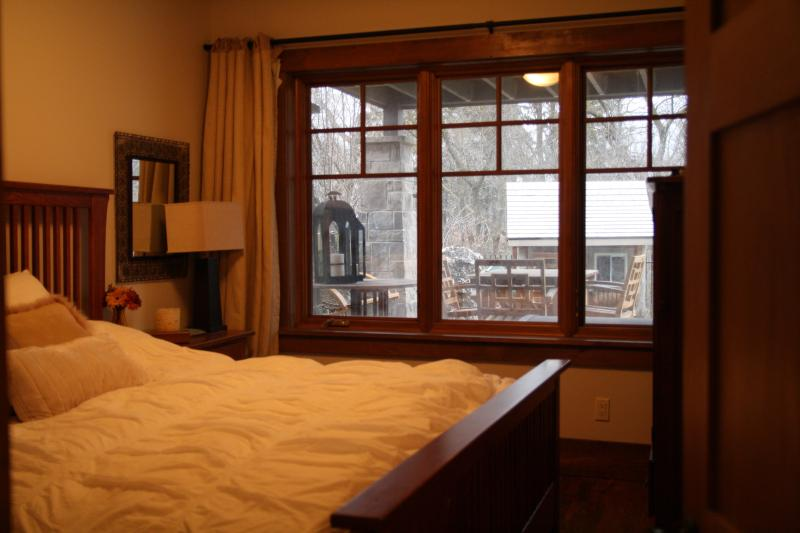 Downstairs bedroom overlooking backyard.  King-sized bed.