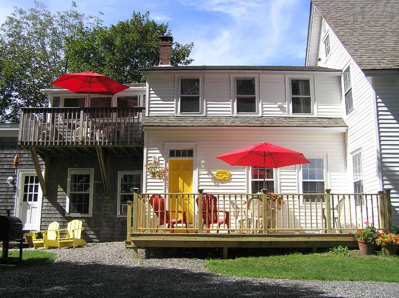 A view of part of the front of the house and the and decks