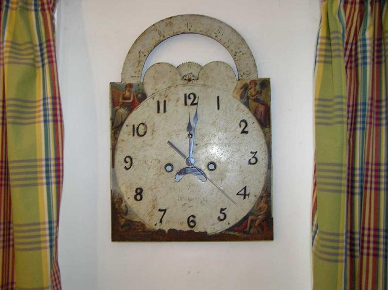 The kitchen clock – modern works behind a genuine painted longcase clock face.