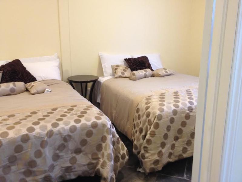 Camera da letto con due letti queen-size