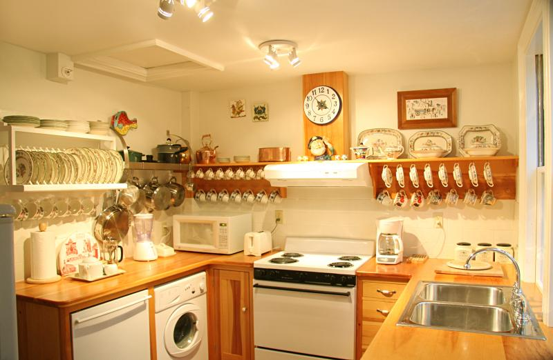 Elegant European style kitchen, with fine English china, dishwasher, washer/dryer, fridge/freezer