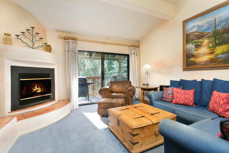 The Summit #G64 Living Area With A Wood Burning Fireplace