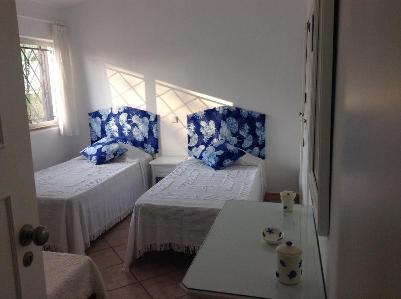 2nd Bedroom with 3 single beds. Two can be made up as King bed