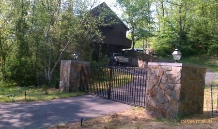 Beautiful Stone & Rod Iron Gate Entrance