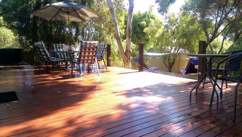 Large deck under shady trees for dining, plus a smaller lower deck - perfect!