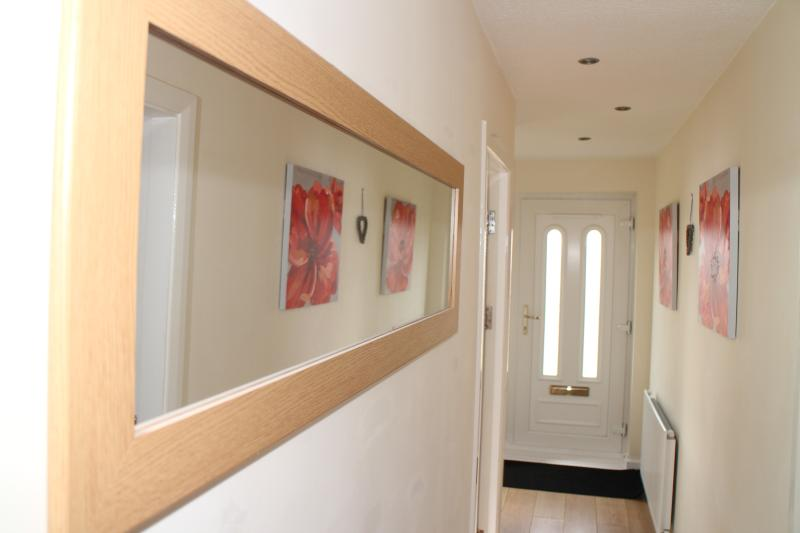 Hall Way, Laminate Flooring, Coat Cupboard, Leading to all rooms,