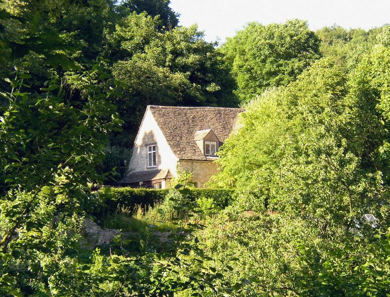 The Tythe Barn at Owlpen is a landmark listed studio set among beams in the medieval Cyder House
