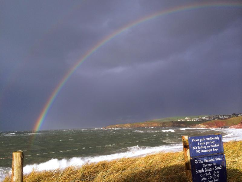 Stormy seas and rainbow over South Milton Sands