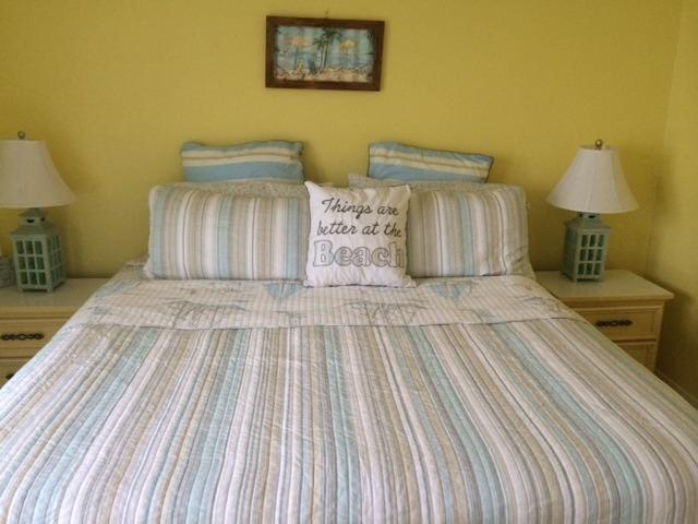 The guest bedroom has a king-sized bed and adjacent restroom.