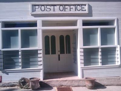Old Post Office sign on the historic Plaza del Cerro.