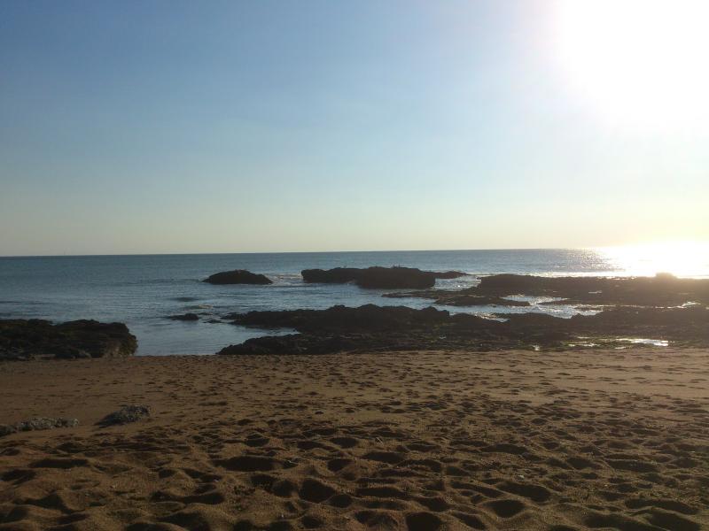 Un bout de plage au coucher du soleil