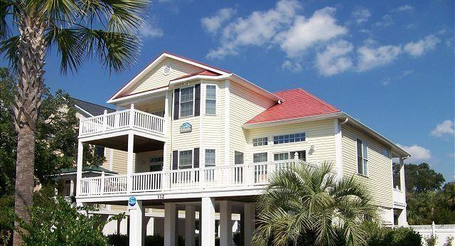 Raised Beach house with ample parking. One minute walk to Ocean.