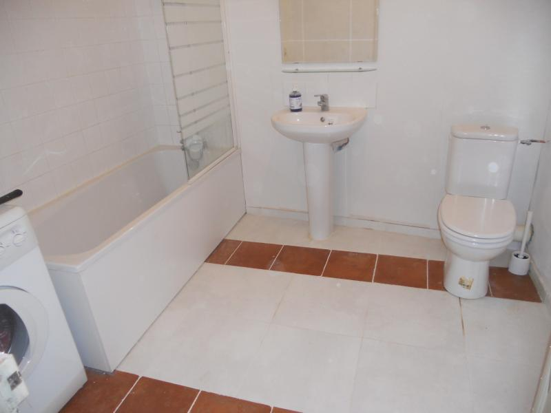 Family bathroom -shower bath,wash basin,wc,washing machine,storage unit