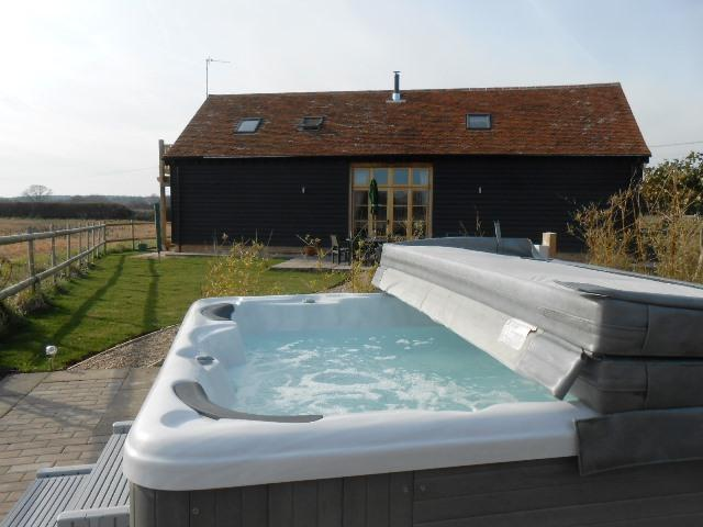 The Shire Stables.  Detached barn with Hot tub.  Open plan downstairs with wood burning stove.