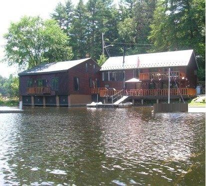 View of the house from the lake while sitting in the canoe, kayak or rowboat we have for your use.