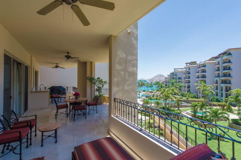 Large balcony with loungers, patio furniture