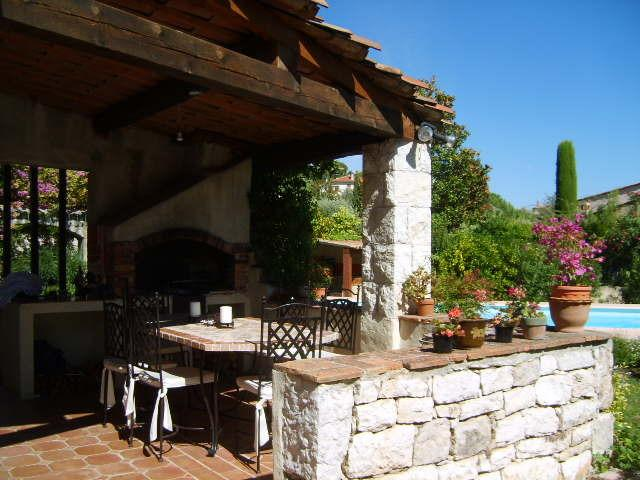 Outdoor dining area with gas barbecue