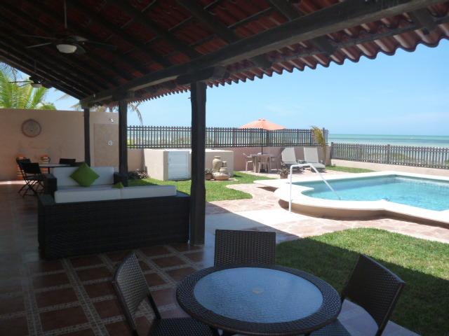 Beach side covered patio showing lounge area