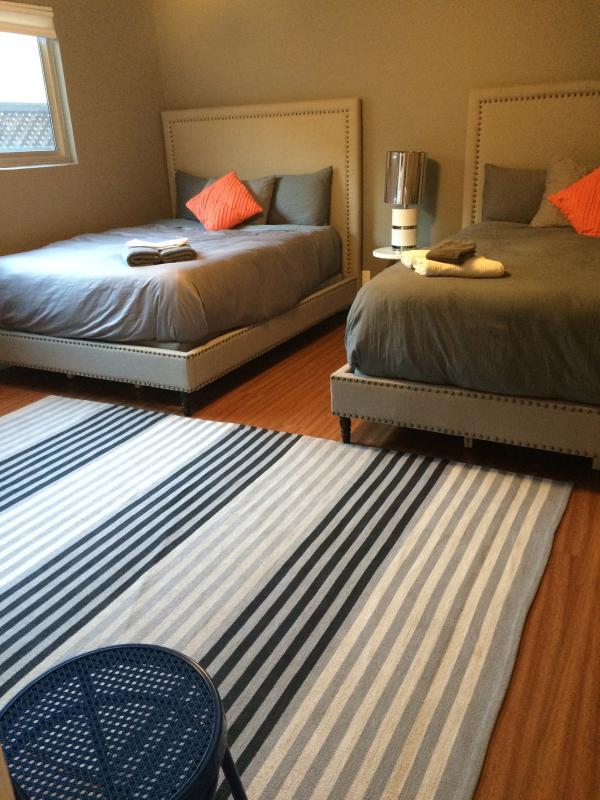 bedroom with 2 comfy queen beds