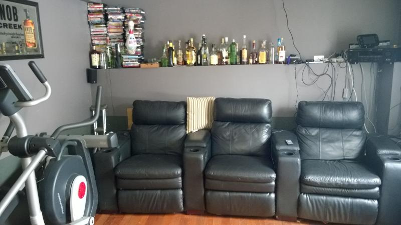 theatre room with 3 recliners and elliptical.  Used as 4th bedroom with included air mattresses