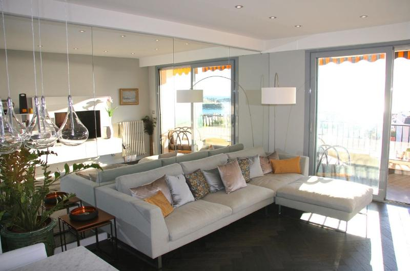 Lounge area with mirrored wall and front balcony beyond