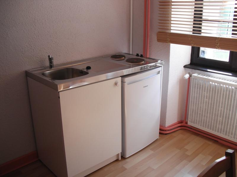 Kitchen with refrigerator, microwave, electric hobs and all the dishware required two