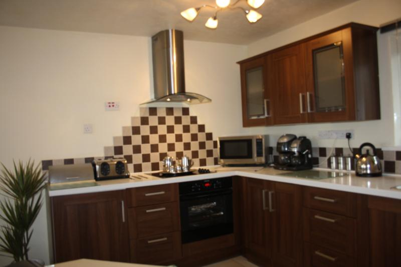 Modern, fully equipped open plan kitchen. Look out the window, up to Blencathra while washing up!
