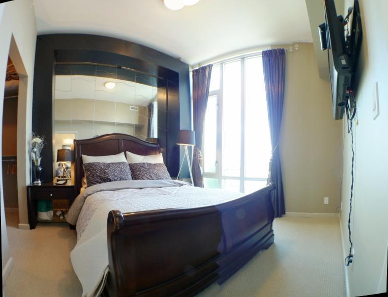 Best View Downtown Apartment by Stampede BMO, location de vacances à Cochrane