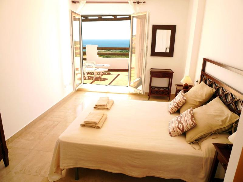 Master Bedroom with terrace, sea view and sunbeds