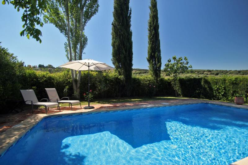 Private swimming pool (8x4 metres), sun loungers, white umbrellas and towels