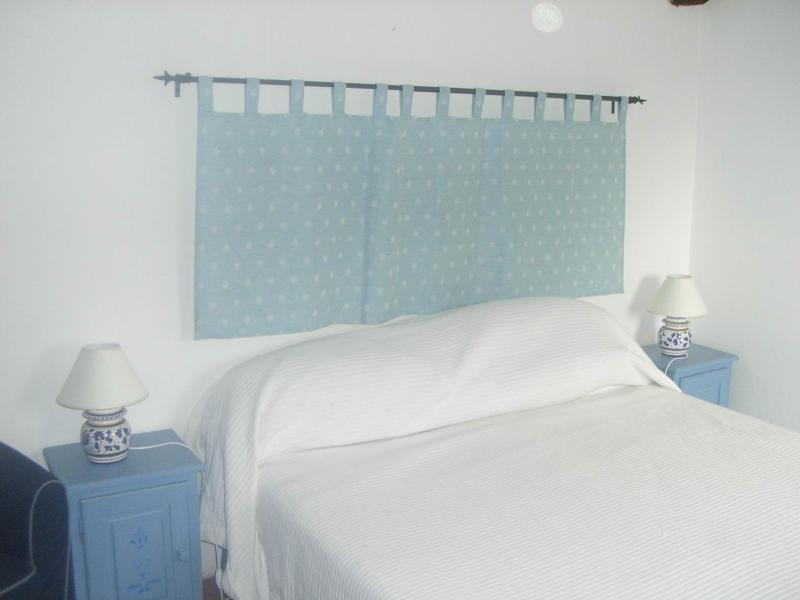The main bedroom is decorated in traditional Umbrian style