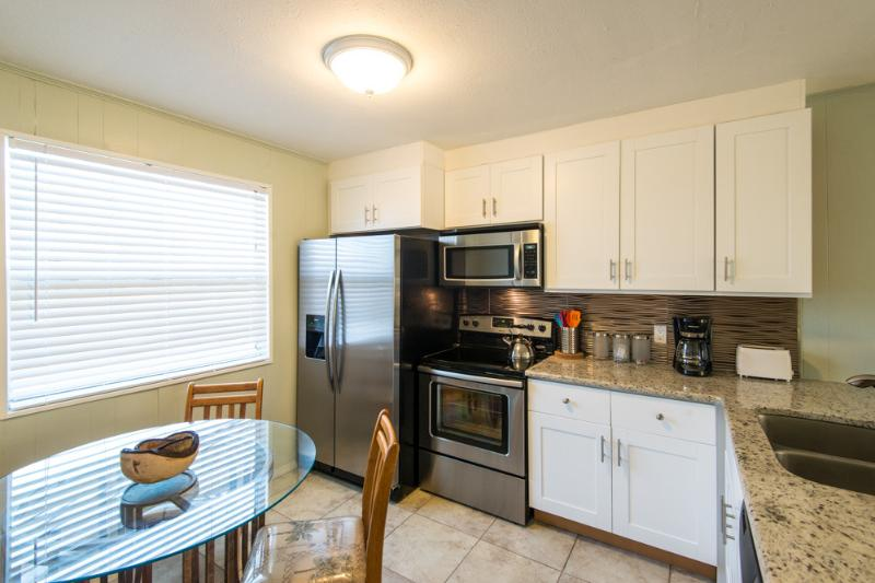 Stainless steel appliances with granite countertops