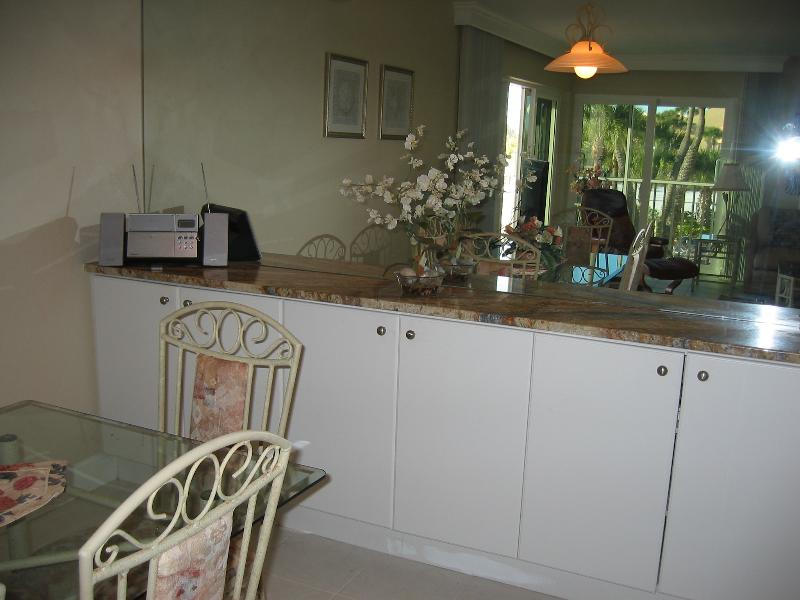 Dining Room, with granite counter over cabinets and mirrored wall
