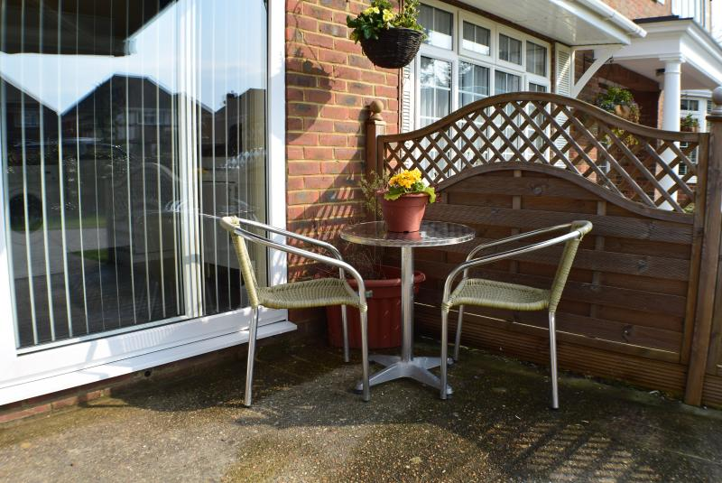 Outside dining area with electric canopy