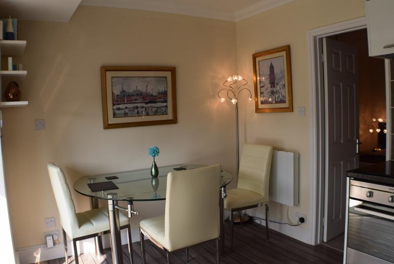 Dining area with stylish table & chairs