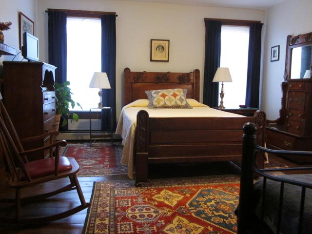 Air-conditioned bedroom with antique queen bed