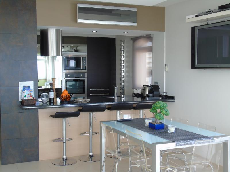 Very modern open space kitchen. cook your meals with a fabulous sea view.