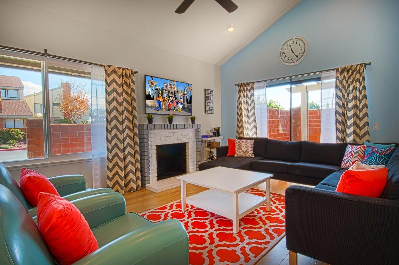 Bright, fun colors, 55' tv, huge couch - this is the place to hang with your family!