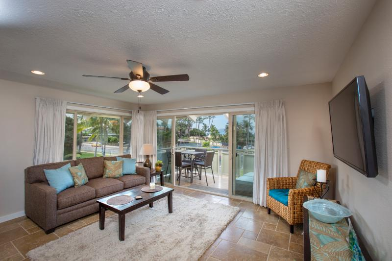 Living room area with lanai and ocean view beyond