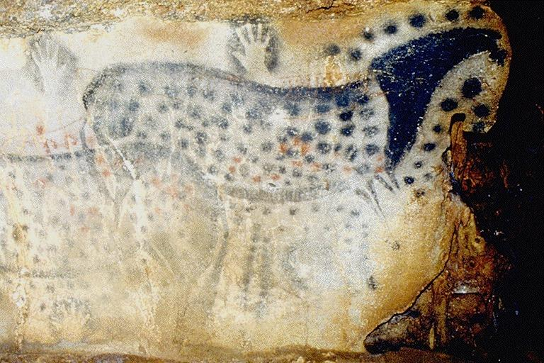 See original 25,000 year-old cave art, like these spotted horses, in the Grote of Pech Merle.
