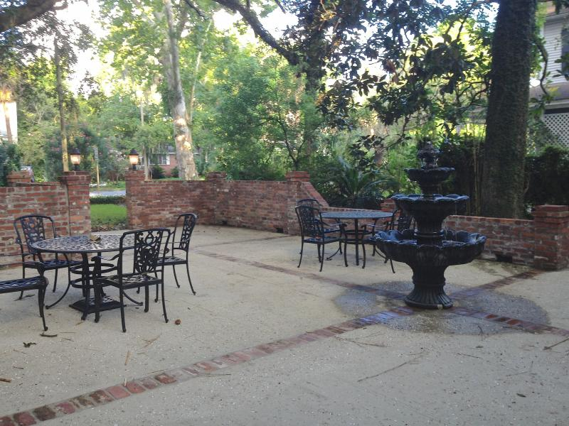 Bubbling fountain, dining tables and custom brick fire/grill