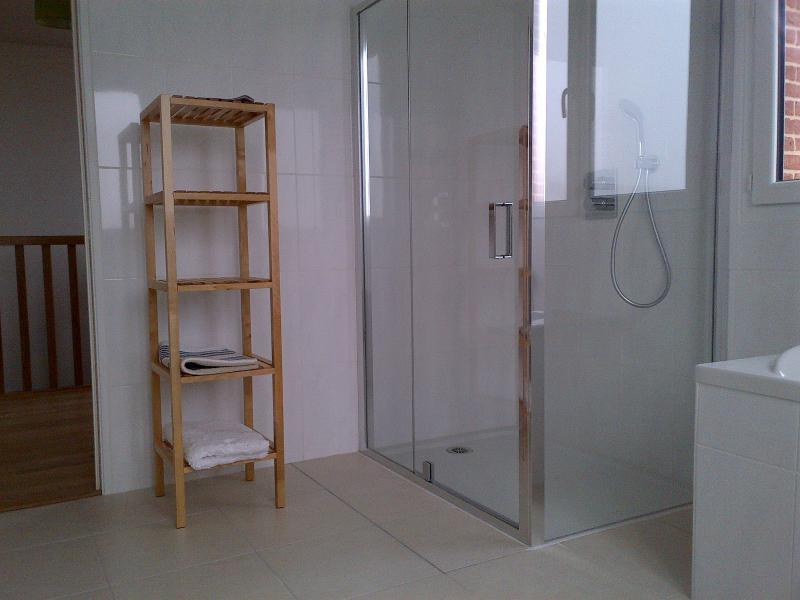 Upstairs bathroom with large shower, bath and double vanity unit and WC. Extra WC next door.