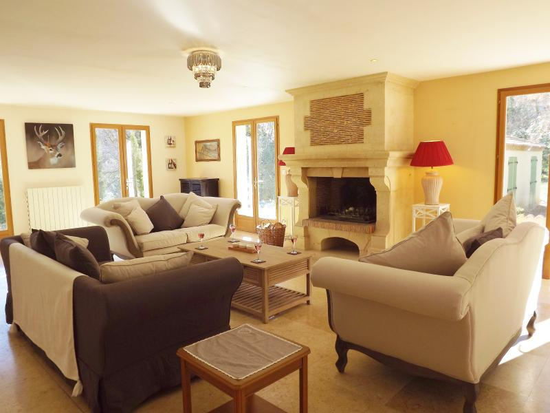 Elegant, light and airy lounge, triple aspect, with patio doors to the, pool and terraces.