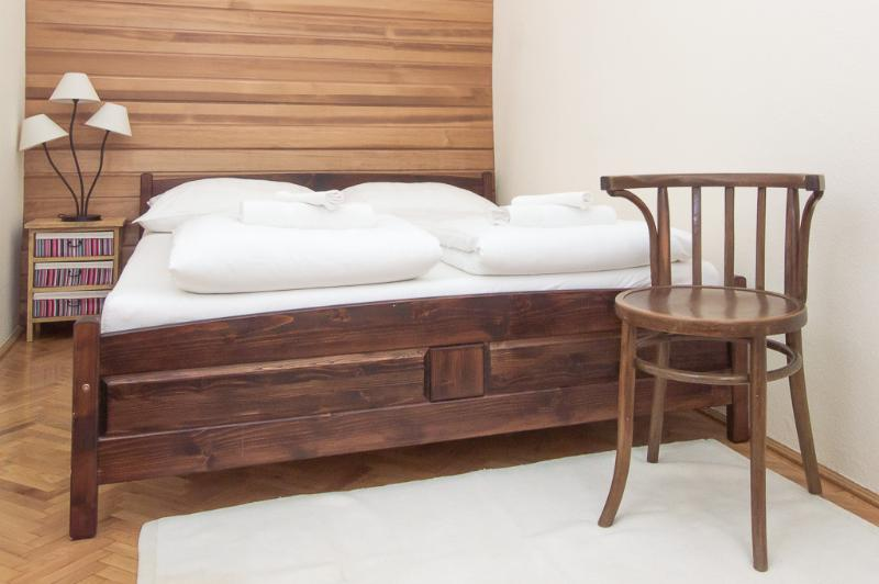 Master bedroom with a medical quality queen size double bed